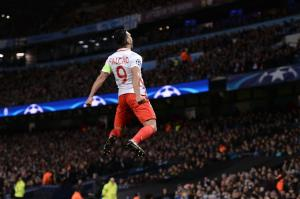 TOPSHOT - Monaco's Colombian forward Radamel Falcao celebrates scoring an equalising goal for 1-1 during the UEFA Champions League Round of 16 first-leg football match between Manchester City and Monaco at the Etihad Stadium in Manchester, north west England on February 21, 2017. / AFP PHOTO / Oli SCARFF